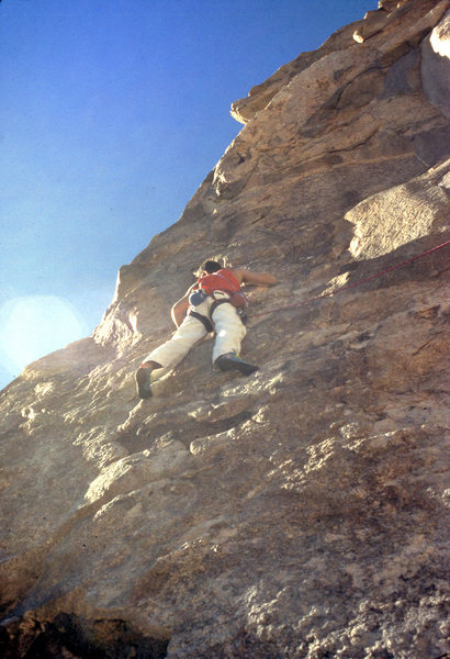 "Scott Cole busy drilling the 1st bolt on ""The Bone Club"" (5.10b) in December 1988"