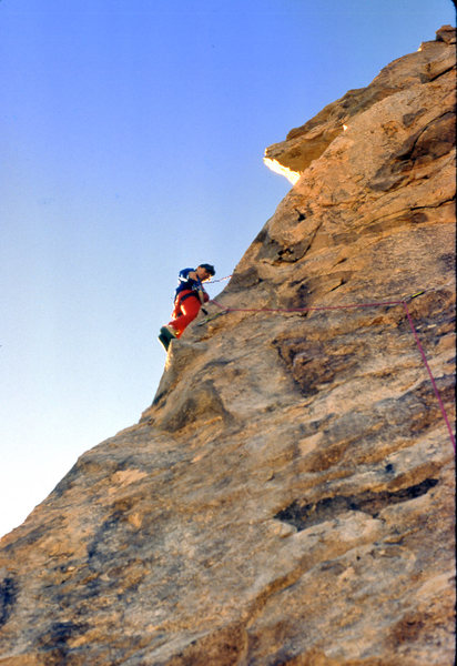 "Getting set to drill the 3rd bolt on the FA of ""The Bone Club"" (5.10b) in December 1988"