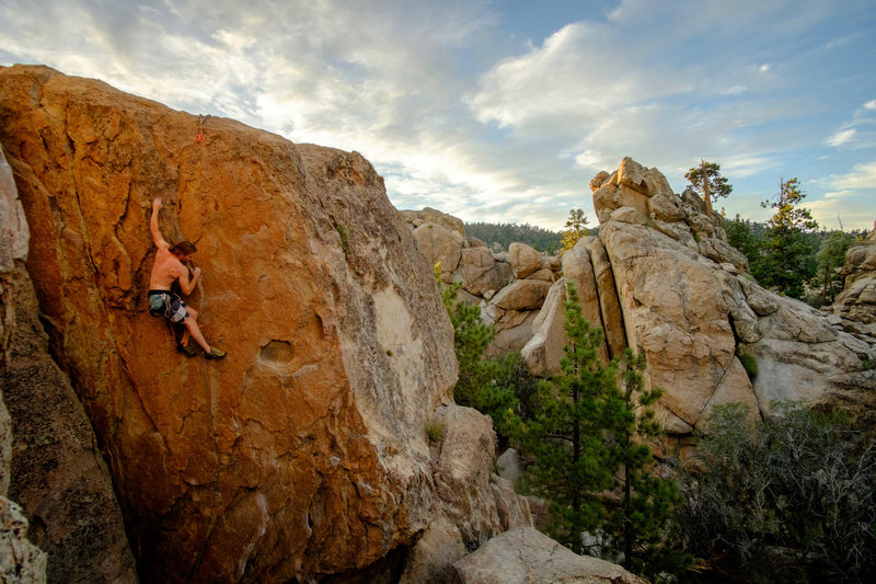 Pulling through the finish of the surprisingly physical 5.10d, Firepower, at the Holcomb Valley Pinnacles