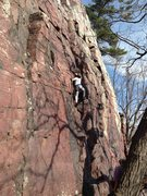 Erik Carlson climbing up the Sunken Pillar route right under Balanced Rock in Devils Lake, Wisconsin.