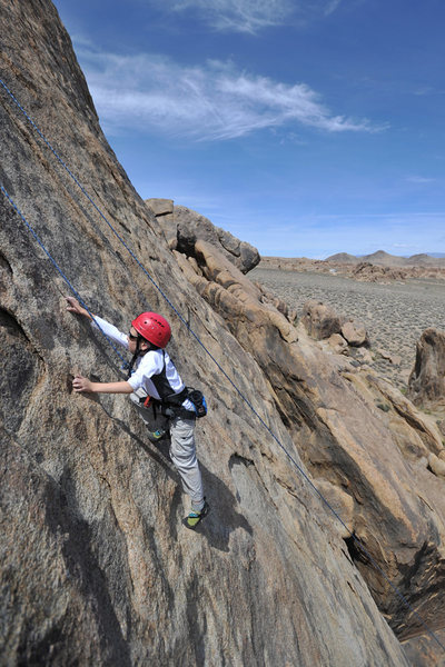 Wesley Fienup climbs Riders of the Purple Sage (5.7) in the Alabama Hills.