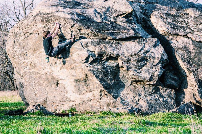 super fun boulder in the middle of a pretty field