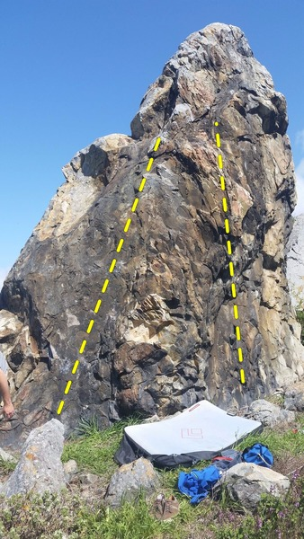Detailed harder climb on the black section of rock to the left maybe a V2-V3 easier climbs on the right maybe V1-V2