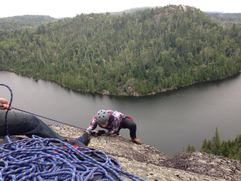 Rock Climbing Photo: Nick topping out on the wolf lake set.