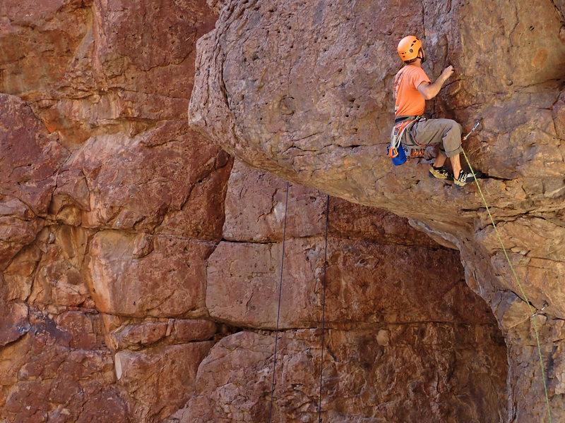 Climb shallow sharp pockets to next bolt.