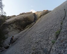 Josh Miller belaying Sam Nichols from the base of the crack.