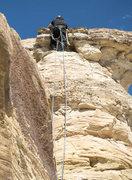 Rock Climbing Photo: Easing over the caprock. Runout but fun free climb...