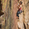 The first bolt is up there, be careful. Photography by Andrew Burr, Climber is Elisha Gallegos