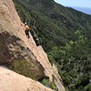 Alex Degolia leads the stunning second pitch of Fun in the Sun, in Rattlesnake Canyon. Patrick Callery belays. Anacapa in the distance.