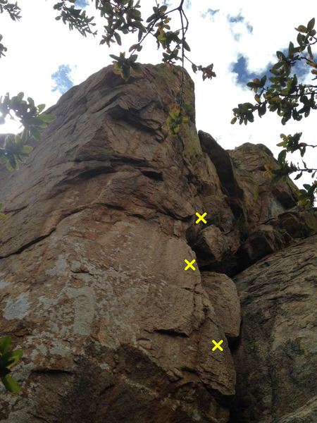 Climb starts with blocky liebacks on the right, then follows the arete all the way up.  First three bolts indicated.