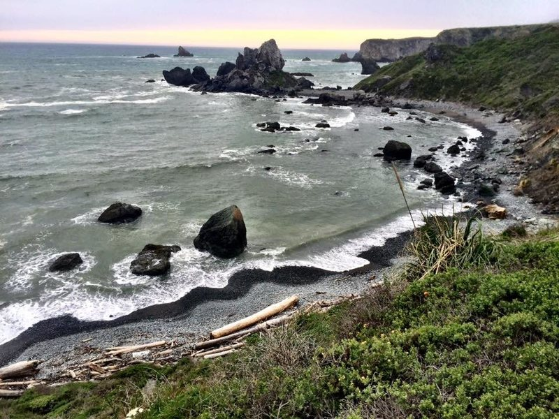 The secret beach adorned with sea glass and jade that leads to Twin Cove Crag