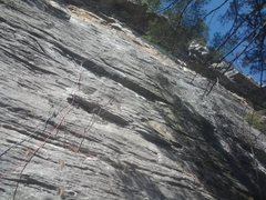 Emilio (5.7+). Climber is below P1 crux.