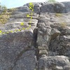 Jenga is the yellow route to the left of the crack with the huge loose block. Bogey is the red route on the right.