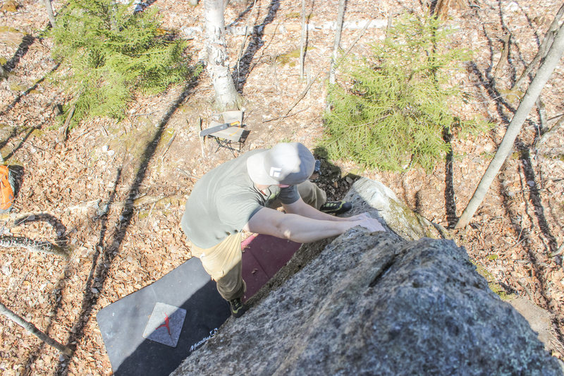 Working up the arete after passing over the starting bulge.