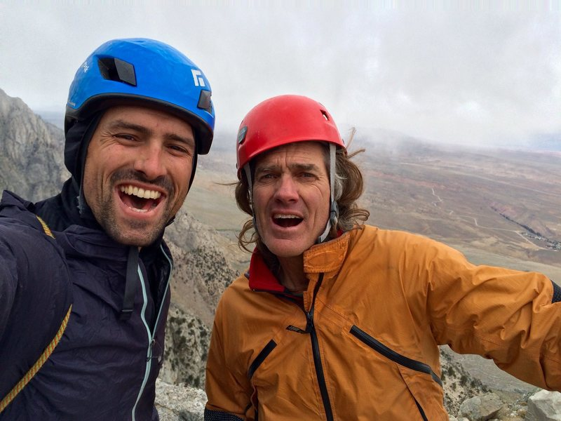 The team, psyched in a snowstorm on the summit of Super Grey Pinnacle.