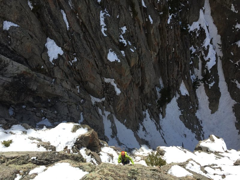 Belaying Ben up the first pitch out of the right couloir, M5, 120'.