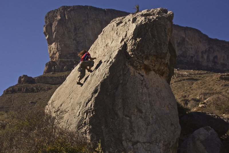 Sean Hible on a previously unclimbed slab. <br> Photo by Honey Davis.