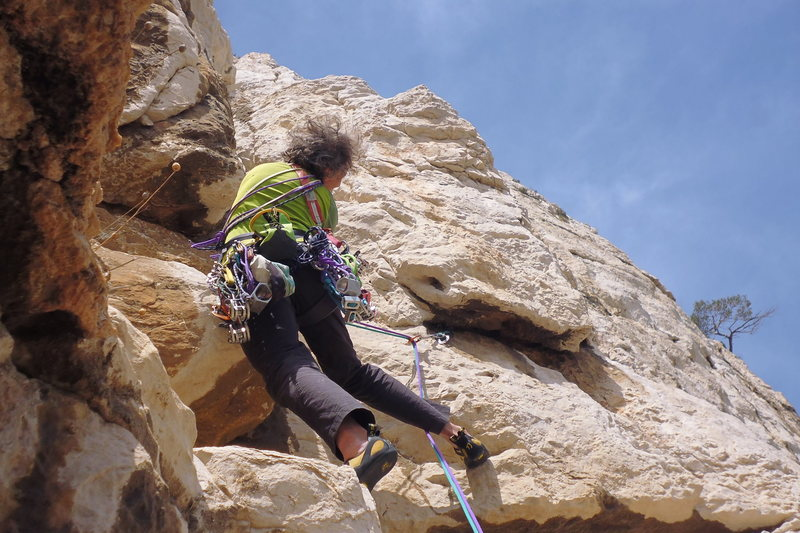 On the Crux pitch in Le Riz au Lait, a nice trad route- 5.10a- in Les Calanques,