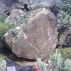 Front of boulder.