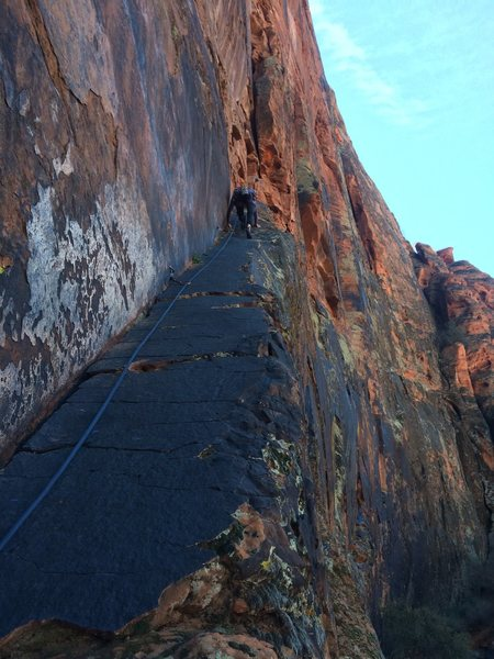 Steph climbing the bolted ramp leading to the start of the first pitch