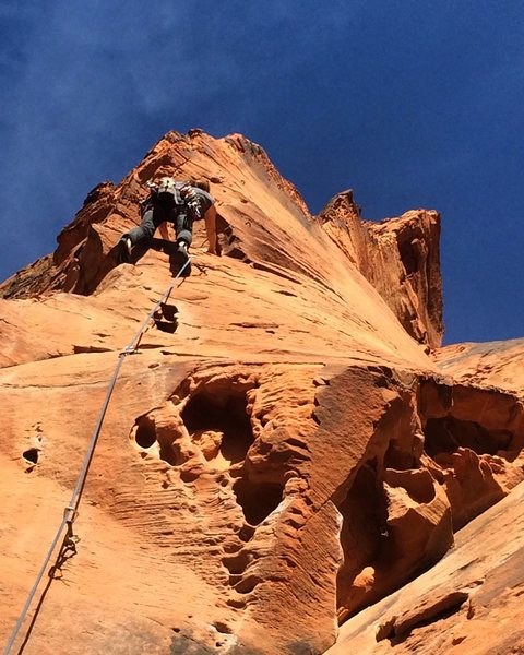 Steph leading the amazing twisting arete of pitch 4 on The Richness of it All.