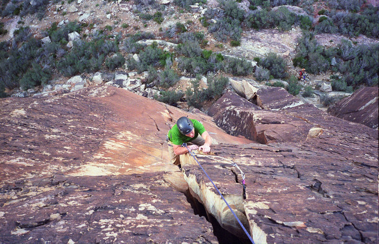 Pulling the roof at the top of pitch three on the way to the summit of Whisky Peak with a smile.