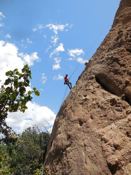 "Rappelling off ""Tethys"" on the Pangea Wall at Texas Canyon."