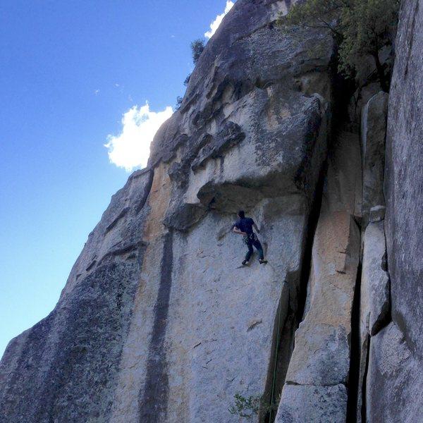Brian Prince stopping for a shake and a dip on Desperado, 5.11d, Pat & Jack Pinnacle, Yosemite