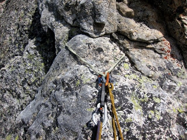 Pinch belay anchor on pitch 5 of the SW Arête