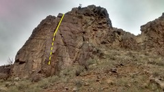 Climb runs along the crack of rear rock, smaller rock in front creates chimney for first section.