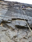Rock Climbing Photo: Bo on the superb black rock of pitch 7, off of the...