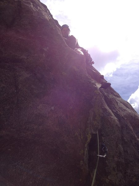 Just above the crux at the start, by the unseen 2nd bolt. The photo was taken into the sun.