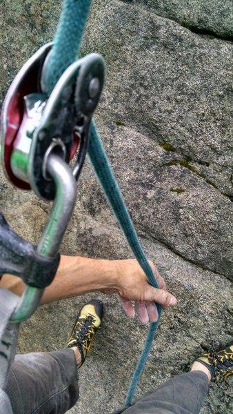 Grab a bight of rope below the mini.