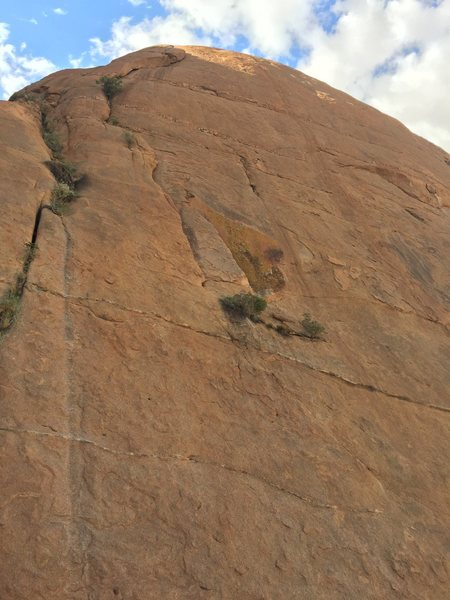 Rock Climbing Photo: The upper pitches of the wall with the obvious ora...