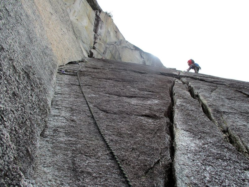 Pitch 3 of The Great Game goes up the 10c corner on the left. The climber in the photo is on The Great Drain which meets The Great Game and then splits off right here.