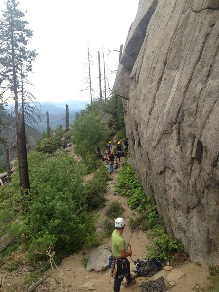 Climbers gathered around Celestial Groove and single climber belaying on Cloud nine.