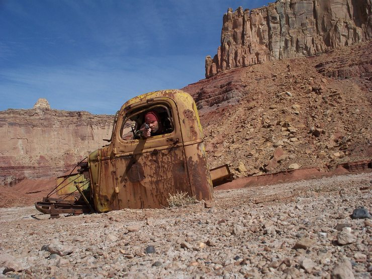 Tomsich Butte truck cab, and some thuggy desert rat.  Top Hat and North Buttes behind.