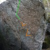 Darkness Falls with the start holds and line of travel shown. This climb starts one hand in a sidepull/crimp in the seam and one hand on a flat crimp. It makes a couple hard moves up and left and then finished up and to the right.
