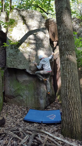 Using the arete to pull up to the slab.  Fun and certainly easier than doing Murder Slab proper.