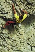 Enrico Maioni climbing 'Il Dau delle nevi'-5.12a - Torre Quarta Alta - © <a href='http://guidedolomiti.com' target='_blank' rel='nofollow' >guidedolomiti.com</a>