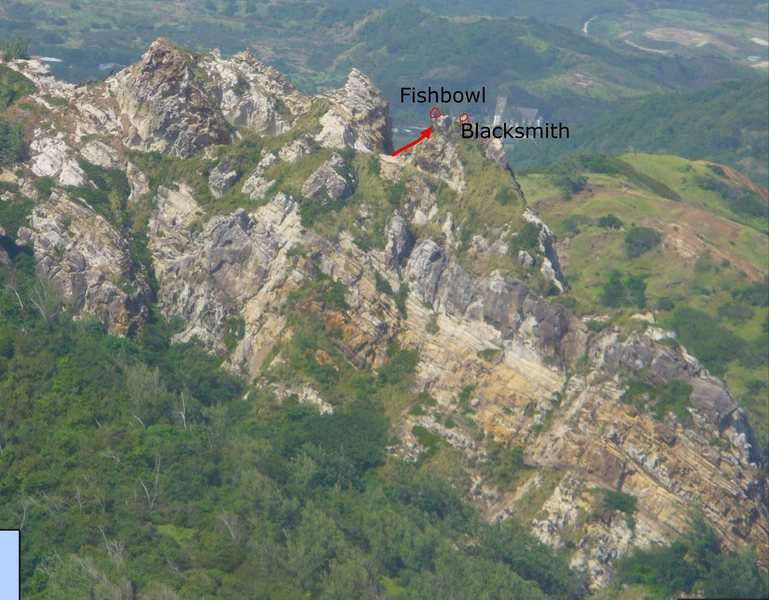 The south face of Sleeping Giant Ridge, which is an area near Barclay's Park in Barbados and is not far from Bathsheba.  There are many different types of sandstone and ironstone here. As a rule of thumb, the darker rocks in this photo are solid, while the lighter rocks will break apart easily.  This photo was taken from google maps.