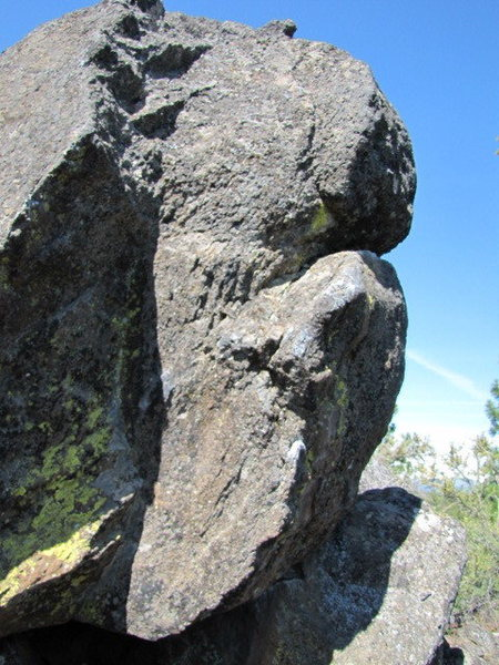Lots of easy variations. 3 easy top outs from rail. Fun Boulder. V4+ starts sitting with left hand on arete and right hand out right on side pull crimper. Pull on and throw to jugs. Left hands works best.