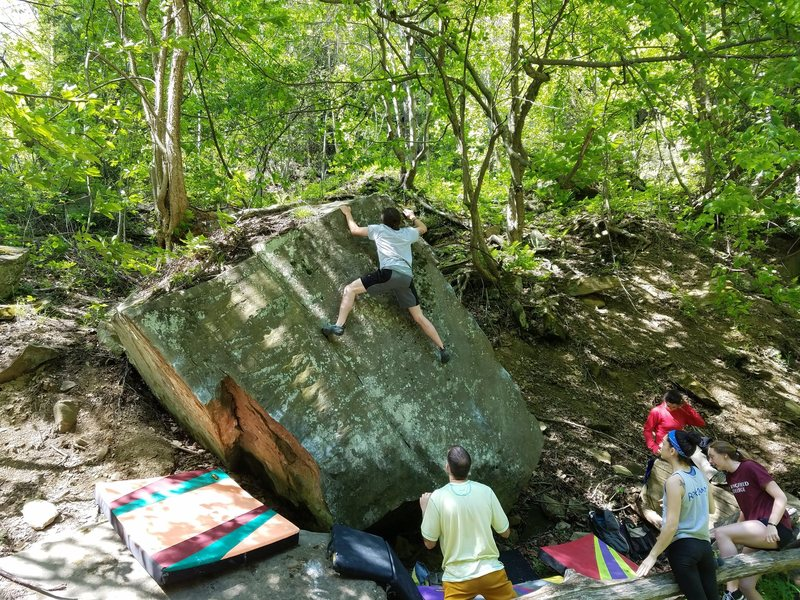 Josh Musial on the unnamed V2 on the triangle slab boulder.