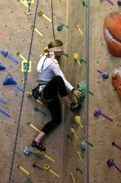 Blindfolded gym climbing