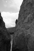 Rock Climbing Photo: Trevor at the third bolt chalking up.