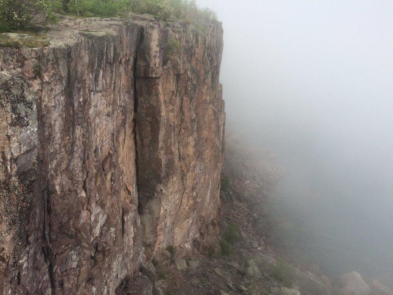 Climber on foggy Superior Crack