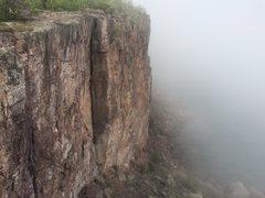 Rock Climbing Photo: Climber on foggy Superior Crack