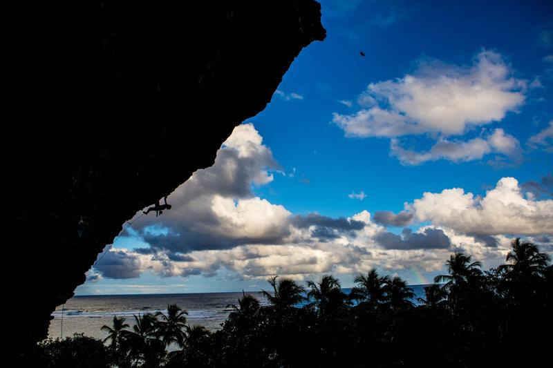 Cody Roth climbing a steep 5.13 at Fronton Beach climbing area.