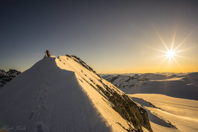 2 climbers along the ridge as the sun rises