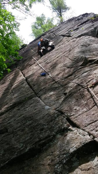Lorenzo entering the cruxy section of WYSIWYG [5.11a Left End, Deadwater, ADKs]